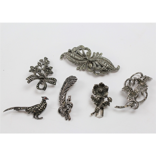38 - A collection of dress brooches, including a Georgian Aigrette, silver and marquisette....
