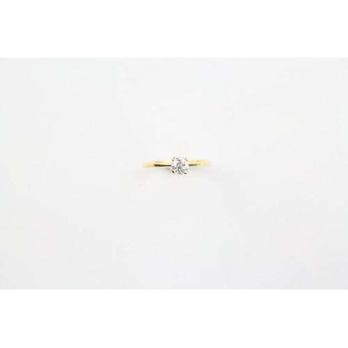 36 - A ladies single stone diamond ring, set in 18 carat gold. Size M.5....