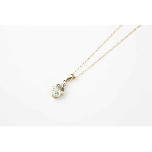 64 - A ladies gold mounted aquamarine necklace, on a fine gold chain....