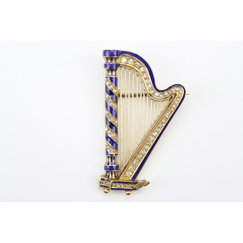 37 - A late 19th century gold and blue enamelled harp brooch, set with diamonds....