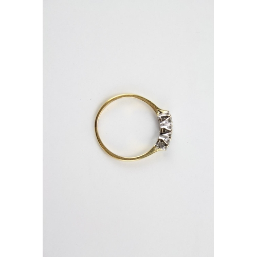 63 - A Ladies 18 ct Gold Ring mounted with three Diamonds. Size:...