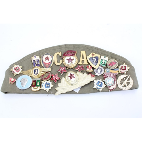 268 - A Russian design badge mounted hat....