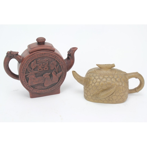 252 - A stone ware Chinese tea pot designed pebble dashed tea pot & one other decorated with chickens....