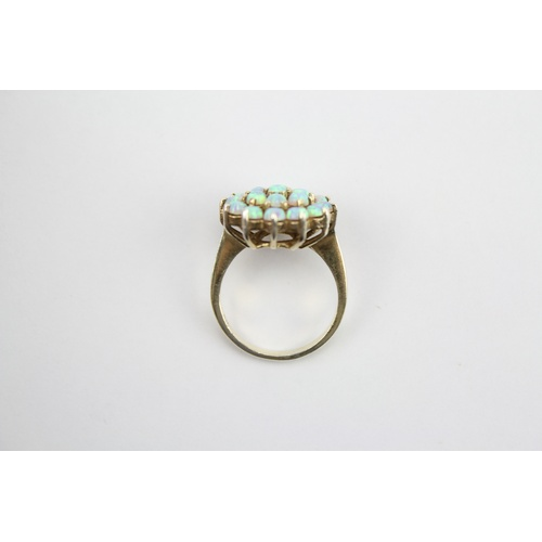 62 - A multi stone cluster Ring set opals. Size M....