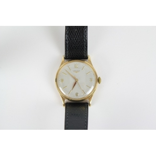 79 - A Gents Gold Longines Wrist Watch on Leather Strap....