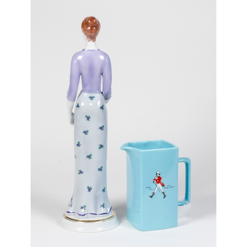 50 - A Still going strong jug and a female figure standing 16.5 inches high....