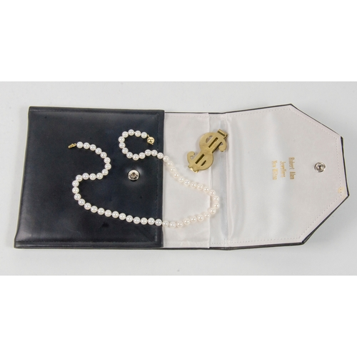 19 - A ladies Pearl Necklace Gold coloured clasp in original black case with a money clip....