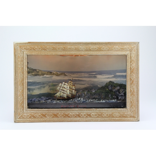238 - A handmade corner diorama, depicting the Cutty Sark, decorated in blue and green....