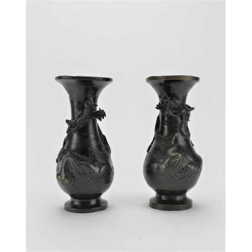 207 - A pair of Chinese dragon decorated bronzed vases. 15cm high....