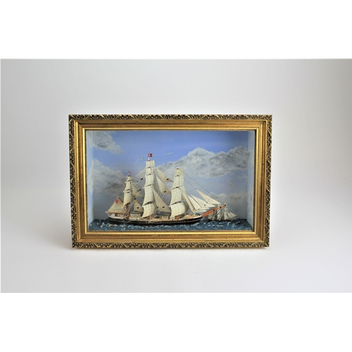 239 - An Arthur Taylor scratch built model depicting a clipper ship in full sail contained in a gilt frame...