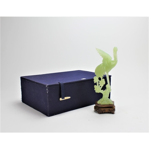 209 - A Green Jade study of a crane in flight, on a wooden stand and in original box....