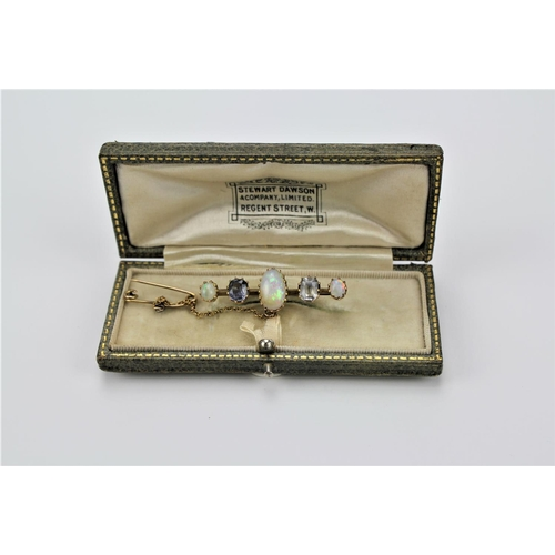 25 - A Victorian opal brooch, three graduated opals and two coloured gem stones contained in original box...