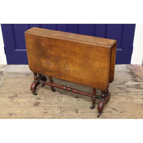 79 - A Victorian mahogany drop flap Sutherland table, resting on twinned turned supports, cross stretcher...