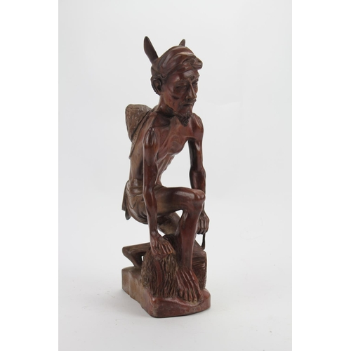 57 - A Scarce Bali School Carving of a study of a fisherman. Measuring: 15 inches High....