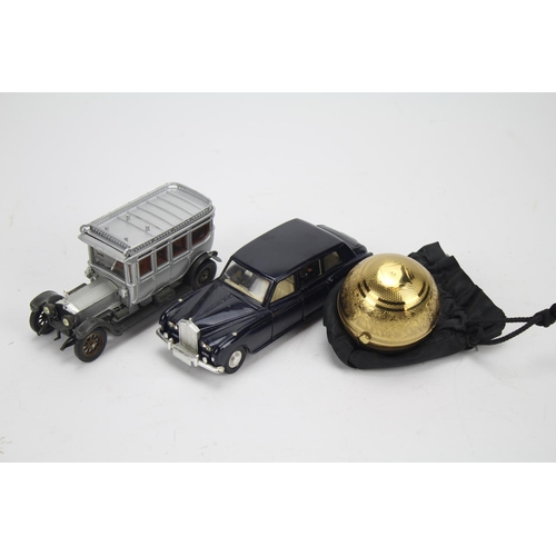 61 - A rare powder compact, Indian design given to vendor by Jim Corbett and two toy cars....