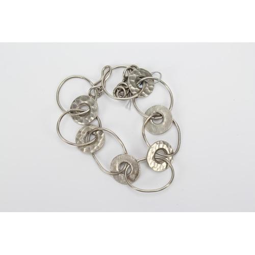 32 - A modern Silver wire work bracelet....