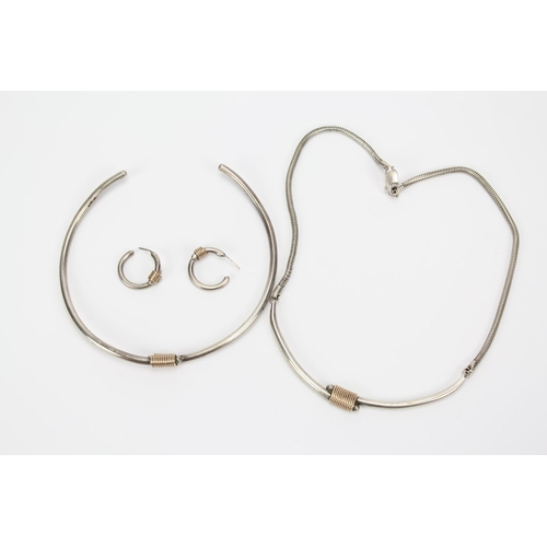 33 - Two modern contemporary Silver Milanese strap tube necklaces....