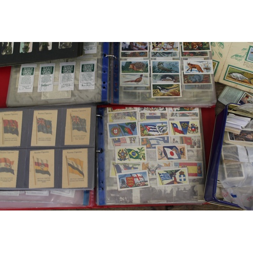 327 - A collection of cigarette cards in albums and loose cigarette cards with trade cards. Needs Viewing....