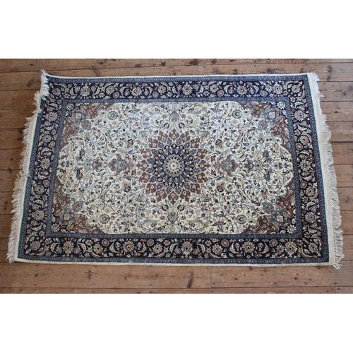 244 - An All Over cream & blue Floral Bordered Central medallion Carpet with central floral design. Measur...