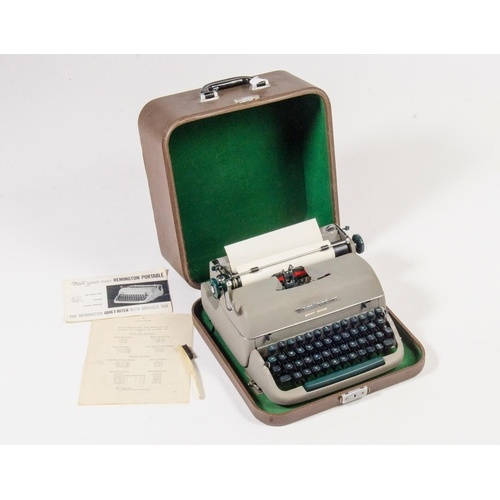 91 - A Remington portable typewriter in brown case with paperwork and in original condition....
