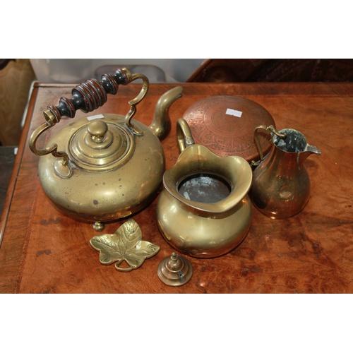 92 - An Antique brass kettle on feet, Islamic engraved box, jugs, metal ware, etc....