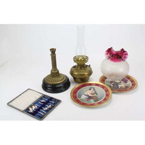 72 - A brass oil lamp with red shade, two  J.K. lady transfer decorated plates & a Set of tea spoons....