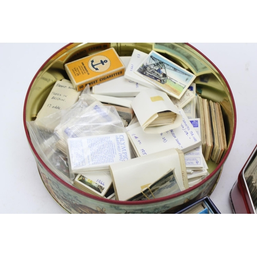 328 - Three tin boxes containing a collection of cigarette cards, containing players, stars, travels & top...