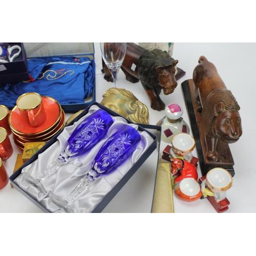 74 - Two hardwood Indian studies of lions, a plaster head, art deco figure, Royal Worcester mug, crystal,...