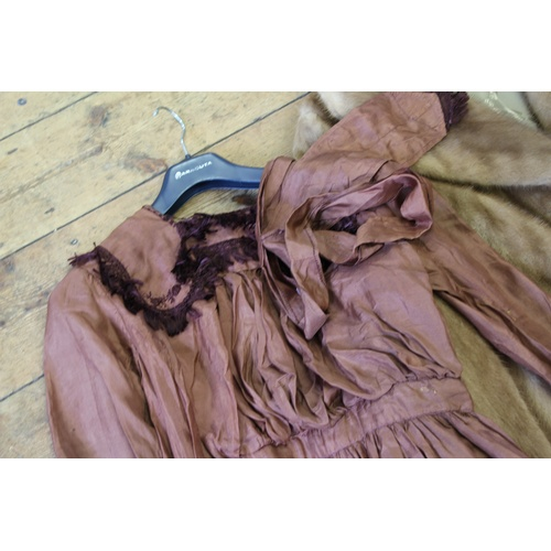 313 - A lady's full length Mus quash fur coat and a Victorian brown shot and fringed edged house maids dre...