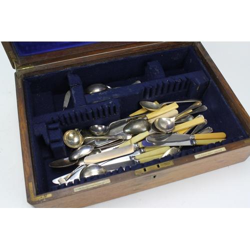 75 - A Oak Case Canteen containing a selection of cutlery....