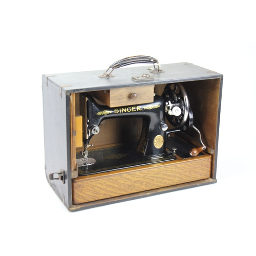 317 - A Scarce Singer sewing machine in a leather bound Case....