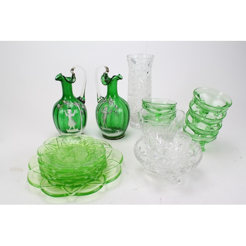 95 - Two green Mary Gregory jugs and a 1930's Green Glass Fruit set....