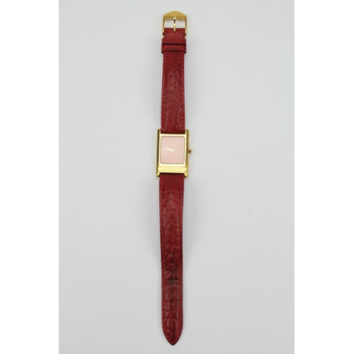 43 - A Ferrari wrist watch swiss made, stainless steel back & red pampa leather strap. Original 1970's....