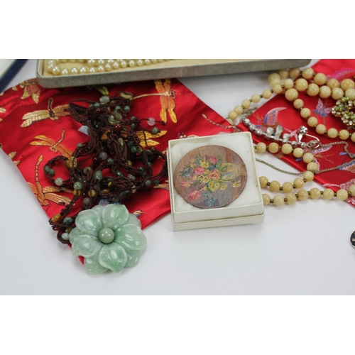 124 - A Chinese hard stone necklace, a box of pearls, beads, etc....