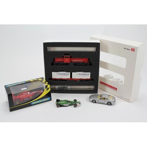 32 - A Scarce DieBahn Train and carriages in Orginal box along with a Scaletrix Ferrari F1 Car in origina...