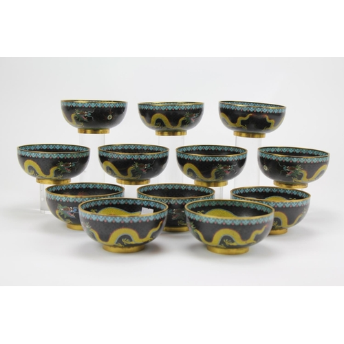 397 - An unusual Set of 12 Chinese Cloisonne Enamelled Yellow Five Clawed Dragons amongst flaming pearls i...