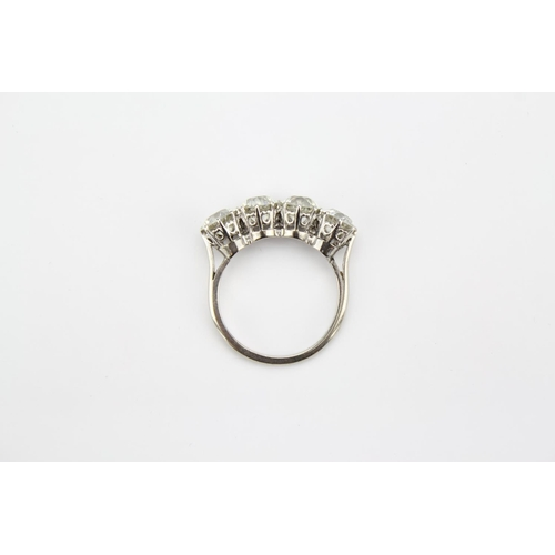 158 - A Ladies Four Stone Diamond Ring set in platinum and 18 Carat white gold, Approx Diamond Weights: 87...