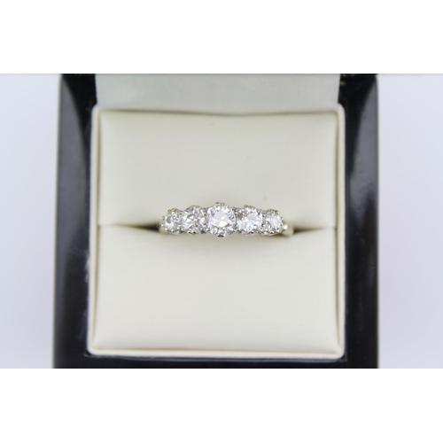 159 - A Ladies Five stone Diamond Dress Ring set in platinum. Centre diamond is approximately .33 carats, ...