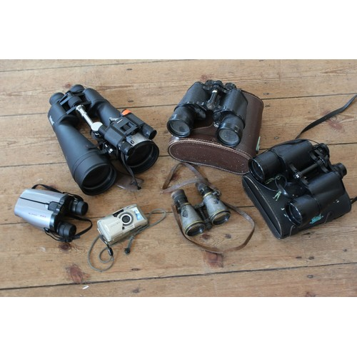 566 - A Box containing 6 x Pairs of Binoculars plus Olympus Camera. AF....