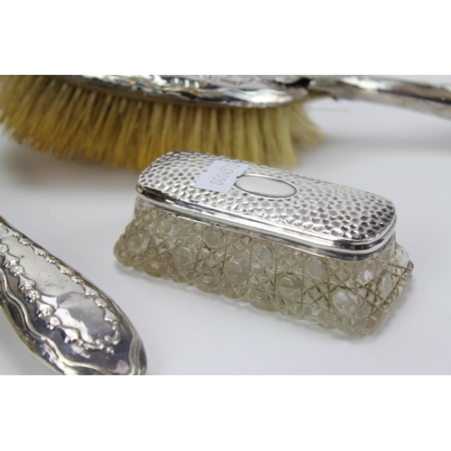 45 - A Silver six piece dressing table set to include four brushes & two glass make-up pots....