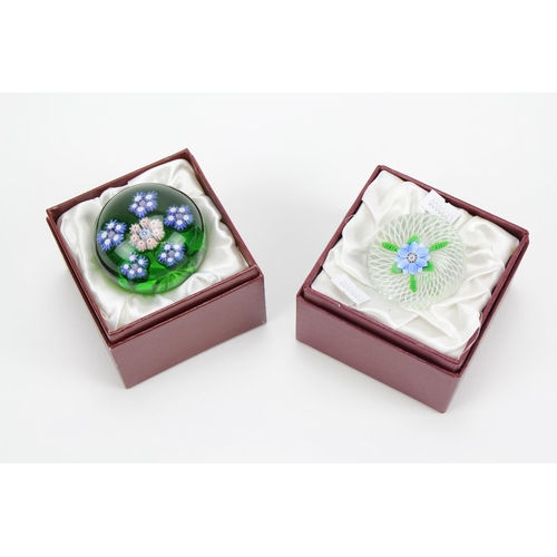380 - A Perthshire Paper Weight of a flower in blue & a Green Millefiori Paper Weight....