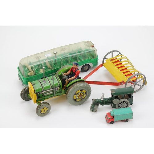21 - A Scarce Mettoy Tractor & Hay rake with Original Driver along with a Plastic Mettoy Coach & 2 other ...