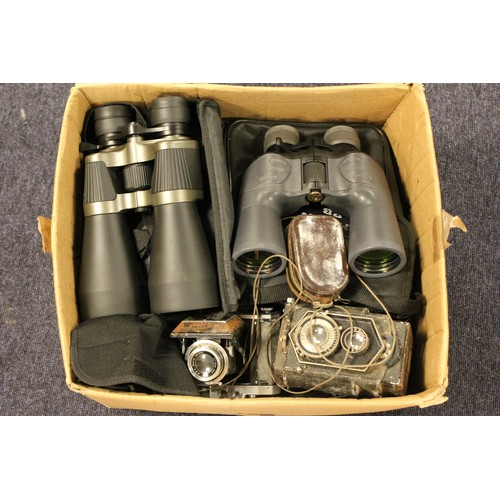 569 - A collection of various cameras and binoculars, etc....