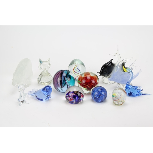 383 - A collection of various glass paperweights....