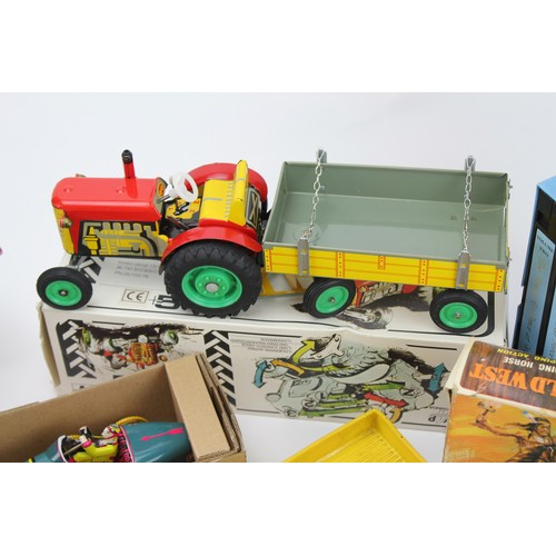 30 - A Large box of Toys to include Boxed Tin Plate Models, a Pond Yacht, a Rubber V.W. Transporter in Ye...