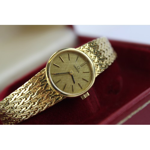 123 - A Lady's Lovely 9ct gold Omega wristwatch on a milanese strap in Original Box with Paperwork....