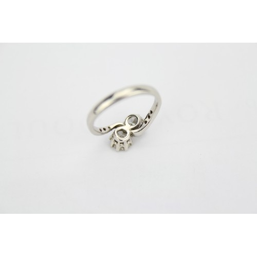111 - A Ladies, Diamond Set Crossover Diamond Ring, Mounted in Platinum with Diamond Shoulders Ring H Size...