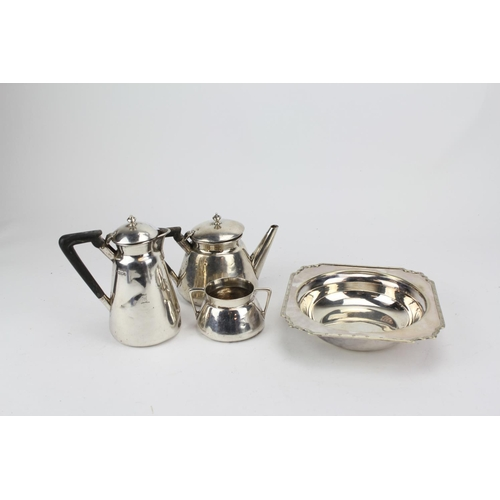 4 - A Three Piece Silver Bachelor Set with Ebony Handles. Weighing 681 grams....