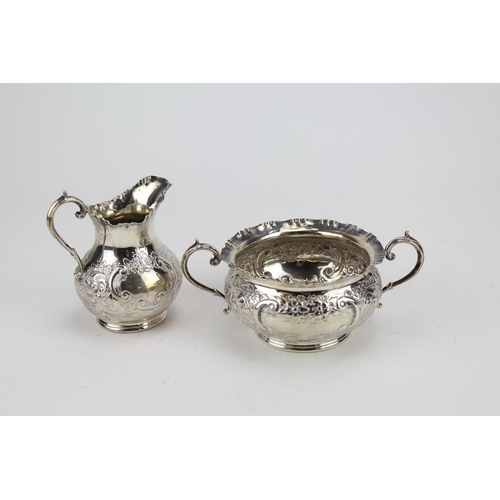 5 - A Victorian Silver embossed Sugar Basin and Cream Jug, Sheffield. Weighing 486 Grams....