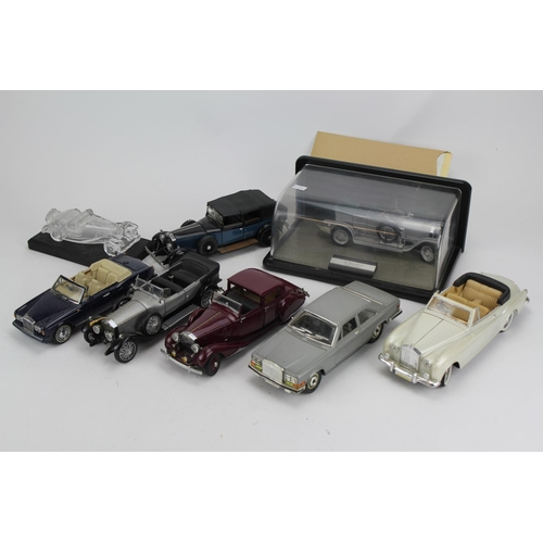 412 - A Collection of 7 Rolls Royce models by Danbury Mint, Burago, Solido, etc complete with Paperwork & ...